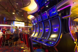 Cape Canaveral, USA - April 30, 2018: Slot machines in the casino on a cruise ship or cruise liner Oasis of the Seas by Royal Caribbean docked in Cape Canaveral, USA on April 30, 2018